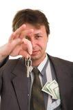 Homem de negócios com dinheiro e chave imagem de stock