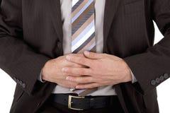 Homem de negócios com dor de estômago Fotografia de Stock