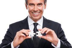 Homem de negócios com elementos do enigma foto de stock royalty free