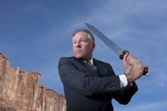 Homem de negócios com espada Fotos de Stock