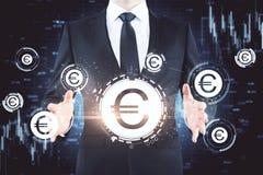 Homem de negócios com euro- ícones imagem de stock royalty free