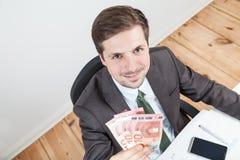Homem de negócios com euro 30 fotografia de stock royalty free