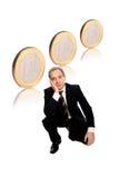 Homem de negócios com euro- moedas Imagens de Stock