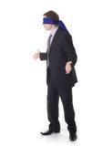 Homem de negócios com a faixa nos olhos Fotos de Stock Royalty Free