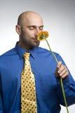 Homem de negócios com flor Fotografia de Stock Royalty Free