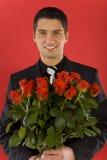 Homem de negócios com flores Imagens de Stock