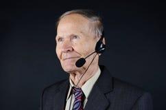 Homem de negócios com fones de ouvido Foto de Stock