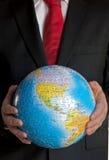 Homem de negócios com globo Fotografia de Stock