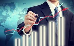 Homem de negócios com gráfico Fotografia de Stock