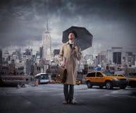 Homem de negócios com guarda-chuva fotografia de stock royalty free