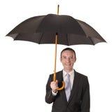 Homem de negócios com guarda-chuva Foto de Stock