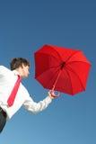 Homem de negócios com guarda-chuva Imagens de Stock