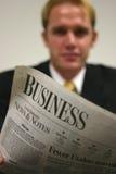 Homem de negócios com jornal Imagem de Stock