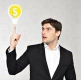 Homem de negócios com lâmpada, conceito da ideia Imagens de Stock Royalty Free