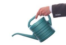 Homem de negócios com lata da água Imagem de Stock Royalty Free