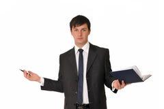 Homem de negócios com livro da leiteria Fotografia de Stock Royalty Free