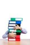 Homem de negócios com lotes dos dobradores Imagem de Stock