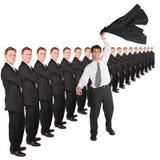 Homem de negócios com a mão ascendente e a equipe do negócio Fotografia de Stock Royalty Free