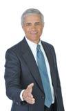 Homem de negócios com mão prolongada Imagens de Stock
