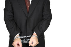 Homem de negócios com mãos acorrentadas Fotografia de Stock