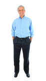 Homem de negócios com mãos em uns bolsos Fotografia de Stock
