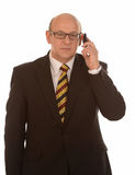 Homem de negócios com móbil Imagem de Stock