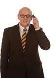 Homem de negócios com móbil Fotografia de Stock