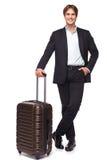 Homem de negócios com mala de viagem Fotos de Stock Royalty Free
