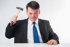 Homem de negócios com martelo Imagem de Stock