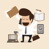 Homem de negócios com multi tasking e multi habilidade Foto de Stock Royalty Free