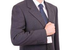 Homem de negócios com o cartão do ás escondido sob a luva. Fotografia de Stock