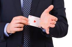 Homem de negócios com o cartão do ás escondido sob a luva. Fotografia de Stock Royalty Free