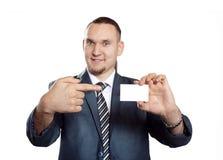 Homem de negócios com o cartão em branco da visita Imagens de Stock