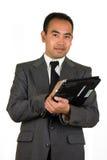 Homem de negócios com o homem Asiático-Americano do PC Imagens de Stock Royalty Free
