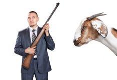 Homem de negócios com o injetor que olha a cabra Imagem de Stock Royalty Free