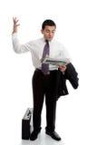 Homem de negócios com o jornal que joga acima as mãos Fotografia de Stock