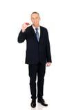 Homem de negócios com o lápis vermelho grande Fotografia de Stock Royalty Free