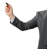 Homem de negócios com o marcador preto na mão isolada no branco imagem de stock