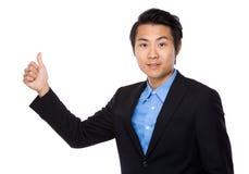 Homem de negócios com o polegar do dedo acima do gesto Imagem de Stock