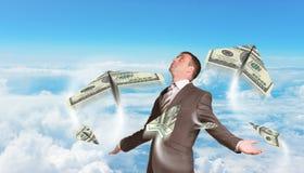 Homem de negócios com os aviões de papel feitos de cem Imagem de Stock Royalty Free
