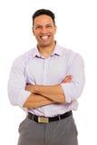 Homem de negócios com os braços dobrados fotografia de stock