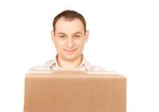 Homem de negócios com pacote Fotos de Stock Royalty Free