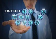 Homem de negócios com a palma das mãos aberta e Fintech com vários ícones do negócio Foto de Stock