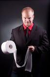Homem de negócios com papel do toilette imagens de stock royalty free