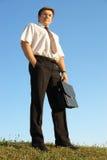 Homem de negócios com pasta Imagens de Stock