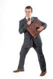 Homem de negócios com pasta e PDA fotografia de stock