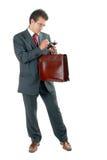 Homem de negócios com pasta e PDA foto de stock