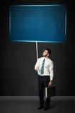 Homem de negócios com placa azul Imagem de Stock Royalty Free