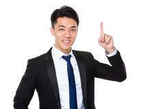 Homem de negócios com ponto do dedo acima Imagens de Stock Royalty Free