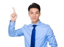 Homem de negócios com ponto do dedo acima Foto de Stock